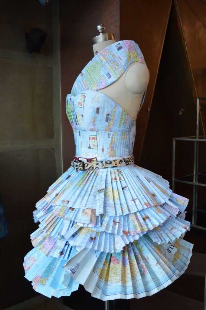 The pretty dress at the entrance is made out of world maps
